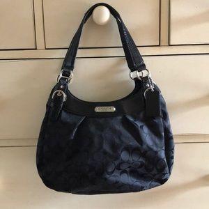 Coach purse—-black signature.  Silver hardware.